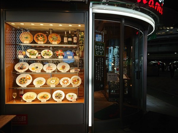 Distinctive and bright display window decorates café façade and attracts visitors at daytime, as well as after dark.