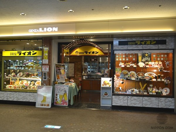 «Ginza Lion» bar display window attracts tourists with a vast assortment of menu items in the international Tokyo airport Haneda.