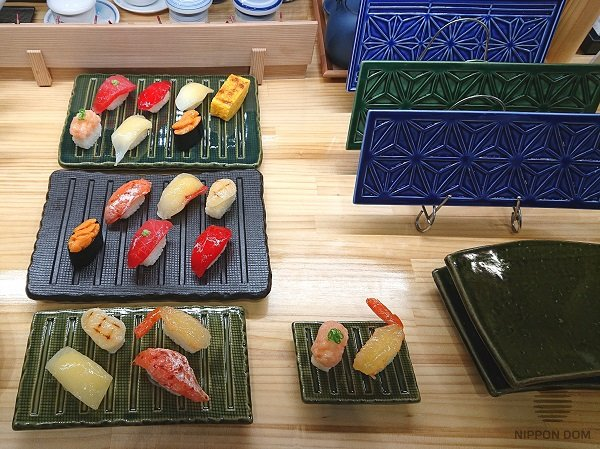 Manufacturer of tableware for Japanese restaurants uses sushi models to demonstrate use of the plates.