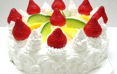 A replica of cake with watermelon, mango and strawberry