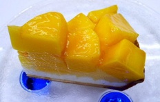 A replica of cheesecake with mango