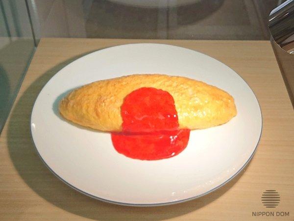 Первый в мире муляж блюда сделал японец Ивасаки Такизо. Копия первого муляжа в музее.