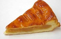 A replica of apple pie, covered with sugar glaze