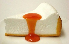 A replica of cheesecake with apricot sauce