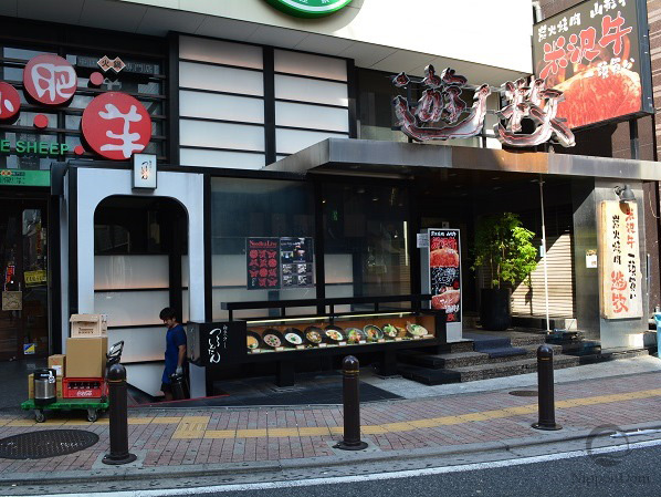"Black color in restaurant's facade ""tells"" about high quality of service and high prices."