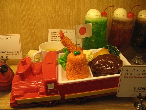 Kids meal contains products from adults menu, but of lesser weight and with less flavoring agents.