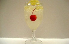 Lemonade decorated with a slice of lemon and a cherry