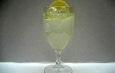 Lemonade decorated with a slice of lemon in a glass