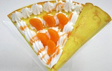 Fake pancake with mandarin and whipped cream