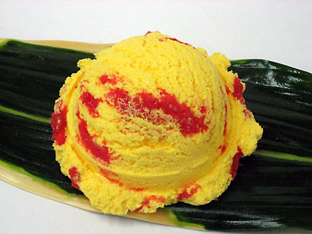 Mango ice cream with strawberry sauce