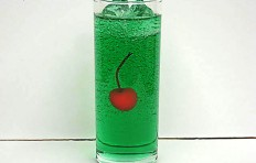 Melon soda decorated with a cherry