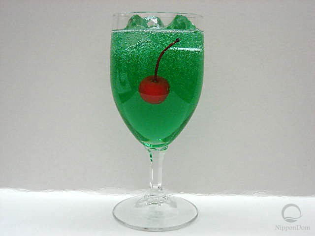 Melon soda decorated with a cherry (glass)