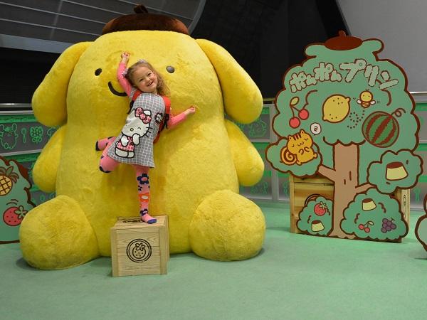 A souvenir photo with a big stuffed toy.
