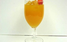 Orange juice decorated with a cherry (glass)
