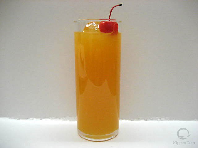 Orange juice decorated with a cherry