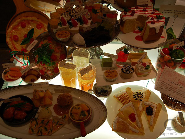 Poor illumination of display window: food models loose their color and delicious look; it is hard to see composition of the meals.