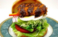 A replica of burger with salad