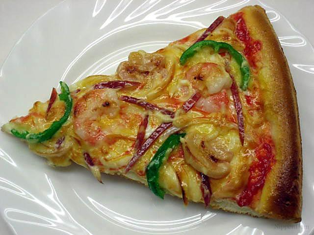 A slice of shrimp and mushroom pizza