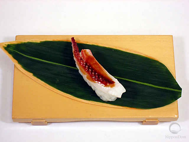 Replica of sushi a small squid tentacle