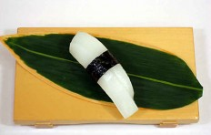 "Replica of sushi ""squid (3) with nori seaweed"""