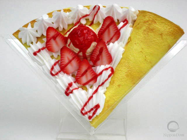 Replica pancake with strawberries and ice cream